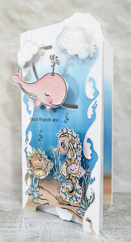 Open view of the entire slimline greeting card project where the sealife is moving with the interactive function of the two dies sold at TLCDesigns.shop papercraft supply store.