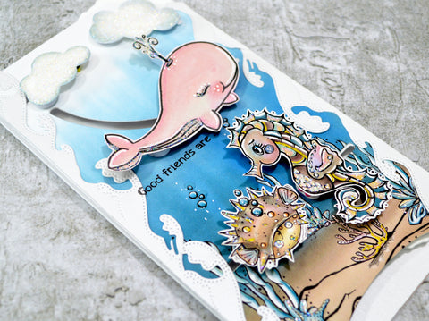 From this side view of the slimline greeting card, the sealife has moved and come to life.  Both of the interactive dies available at TLCDesigns.shop paper crafting store really have filled this project with action and movement for that realistic touch.