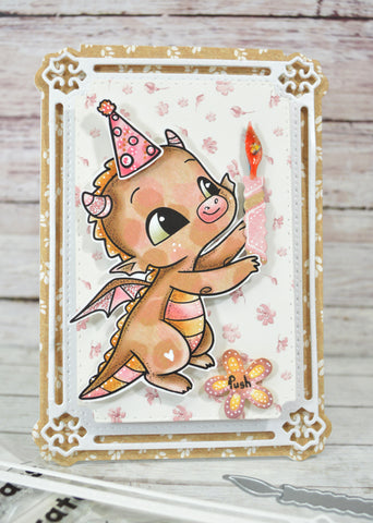 Happy the Dragon holding a light up candle with the mechanism button on the greeting card to assist in the interaction of this greeting card project with the products from TLCDesigns.shop