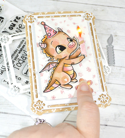 The card to illuminate your greeting!  Happy the Dragon stamp is holding a die cut paper candle that when you push the button on the card light up!  All the interaction anyone could ever need in a birthday card project!  From TLCDesigns.shop