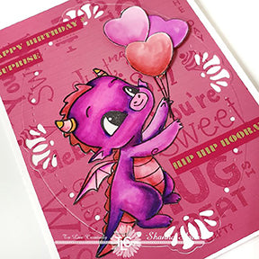 Happy the Dragon stamp is in purples and pinks on this DIY background designed greeting card project with the Oval Lily die cut frame from TLCDesigns.shop
