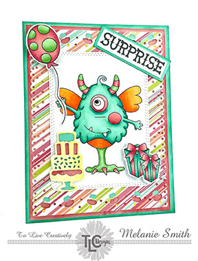 It's a colorful birthday for One Eyed Harry, his balloon, cake and presents today on an adorable striped designer paper cut out with the Celebrate Frame die from TLCDesigns.shop! He's stamped out, colored in mint green copic markers and propped up in the center of the card! Just where he belongs!