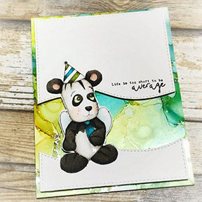 The foil makes all the difference in the world on this greeting card from heaven! The Yupo paper colored background is in greens and olives set apart from the topper of white with the Jazz digi stamp colored up as an adorable little gentlemen bear with his tie and party hat! The project for TLCDesigns.shop stamps