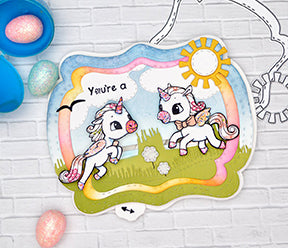 Moving Alicorn stamp images from the edges of your project to the center with the Alicorn Happiness stamps and the See You In The Center die product from TLCDesigns.shop