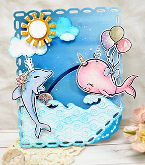 TLC designs paper crafting die called Aztec Sunshine Circle has adorable little embellishment dies to create a bright sun shiny day. This is a oceanic scene with the Fancy Fin Whale and dolphin used in coordination with the land and sea die too!