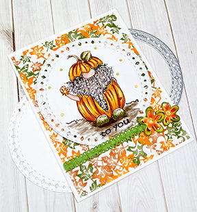 The Aztec Sunshine Circle paper crafting die from TLC Designs is the perfect offset die for any project in any season! This card is focused on Jack O' Gnome freebie digital image and the Celebrate Ribbon die from TLC Designs is used as well.