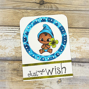 The Aztec Sunshine die and the Celebrate Sentiment stamp from TLCDesigns.shop and the baby elf are just too cute on this greeting card project by TLCDesigns.shop