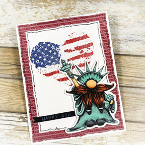Gnorman for all on the delightful backdrop of a heart decorated like the american flag! The perfect greeting card to say Happy 4th of July available as a free digi stamp at TLCDesigns.shop