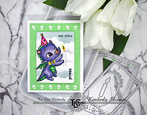 Yep!  It's Happy the Purple dragon with his pink party hat!  He's carrying the LED and battery pack EZ light product on the top of his birthday candle!  Set inside the Celebrate Frame die from TLCDesigns.shop it's the perfect bow tie ocassion for your next celebratory greeting card make!