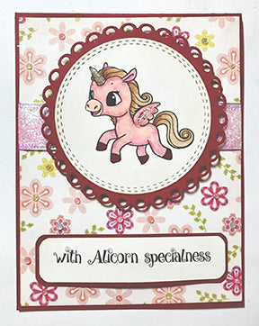 This greeting card in floral pink paper backdrop is with Alicorn specialness like the sentiment says! The doily circle in the center is highlighted with a stamped image from the TLCDesigns.shop Alicorn Happiness stamp set