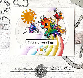 The rainbow colored Alicorn is gallopping over to his butterfly friend in the center of this greeting card just under the sun and over the rainbow! Stamps and dies by TLCDesigns.shop