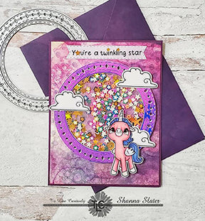 Shanna has made a deliciously purple shaker card full of glittered star sequins today with the Main die from the Aztec Sushine die and the Alicorn Happiness stamps set by TLCDesigns.shop! Shake it up!