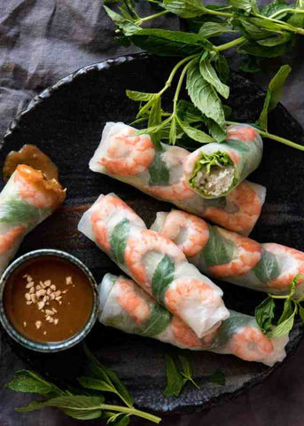 A photo of the completed Vietnamese rice paper rolls, with prawns and mint