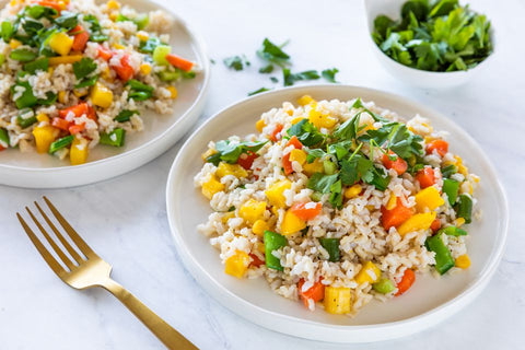 A photo of a full, colourful vegan Asian rice salad