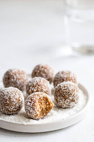 A photo of 7 of the completed salted caramel bliss balls