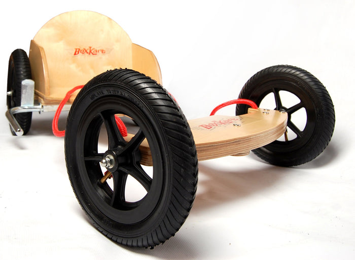 Our Natural Boxkart features a natural timber look, with knobbly pneumatic tyres