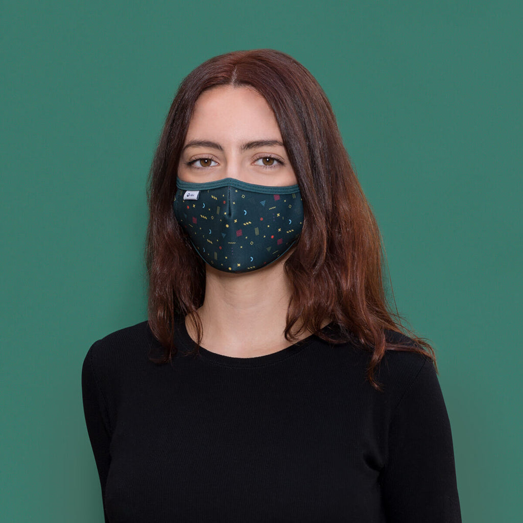 Woman wearing Aguas Calientes face mask
