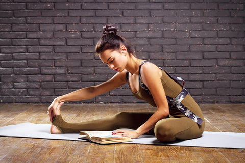 yoga mat and yoga book