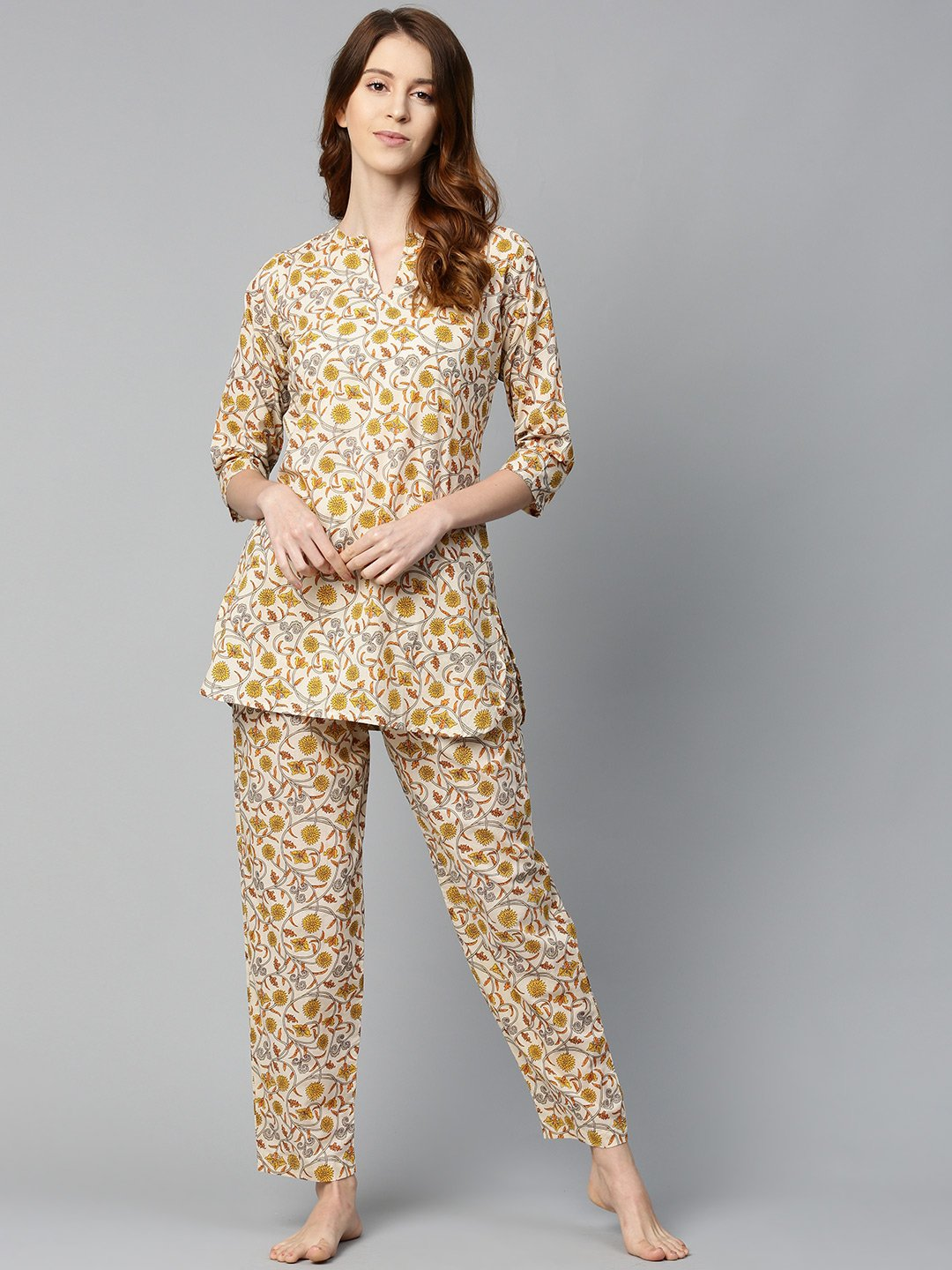 Women Cream And multi floral prnt Top and pant set