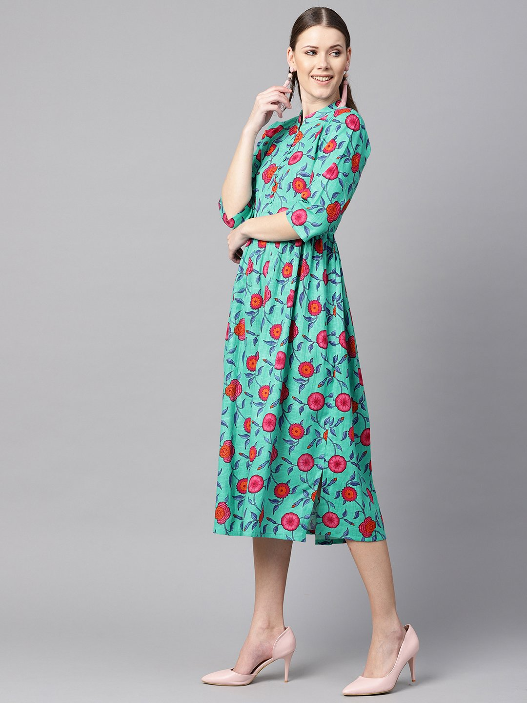 Blue colored Floral Printed 3/4th sleeve pleated dress