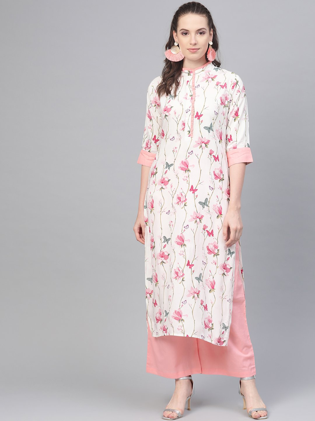 Off white multi colored floral kurta with collar and placket detailing with solid light pink pallazos