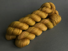 Load image into Gallery viewer, Oro.  Fingering 100% Merino SW (4320840679458)