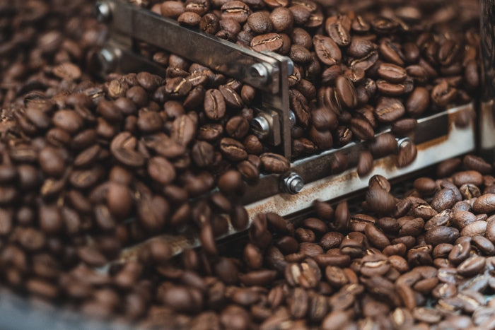 Close up of different coffee roasts in roasting machine