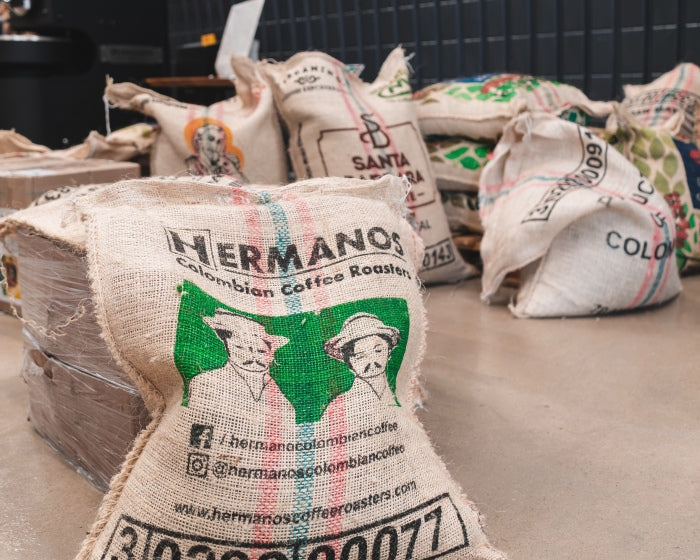 Hermanos coffee sack containing specialty arabica coffee beans from Colombia