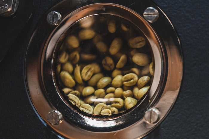 close-up-light-roasted-colombian-coffee-beans-inside-roasting-machine