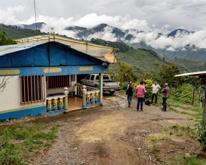 A farm within the Colombian coffee triangle amidst steep mountainous landscape
