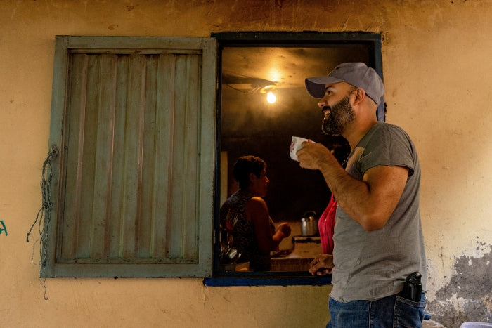 Photo of Hermanos owner Santiago drinking coffee in Colombian coffee triangle