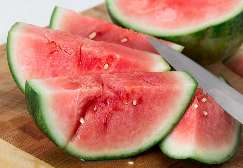Slices of seedless watermelon with a knife blade