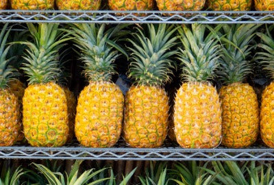 Pineapples for sale on a shelf