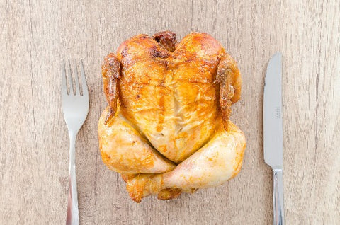 Baked chicken with silverware