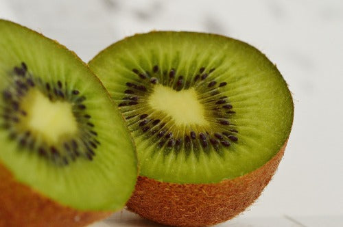 One kiwi sliced in half