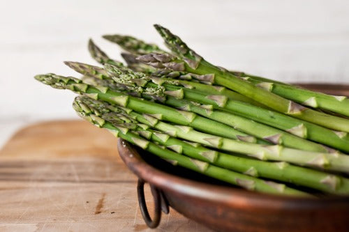 Asparagus in a wooden bowl