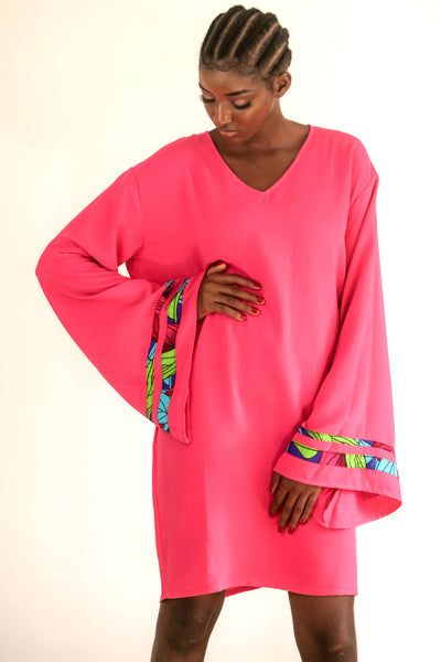Pink Kaftan with strips of African print wax on an exaggerated sleeve. It is so easy to throw one on and get on with the day