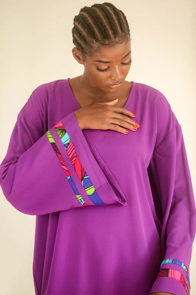 Purple Kaftan with strips of African print wax on an exaggerated sleeve. It is so easy to throw one on and get on with the day