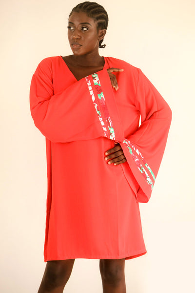 Red Kaftan with strips of African print wax on an exaggerated sleeve. It is so easy to throw one on and get on with the day