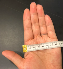 hand being measured for bangle size
