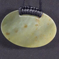 Reverse view Jade breastplate pendant, oval shape, flat surface