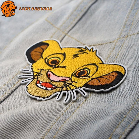 Patch Lion Simba sur jeans