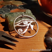 Load image into Gallery viewer, Eye of Horus, Hand Cut Coin Pendant.