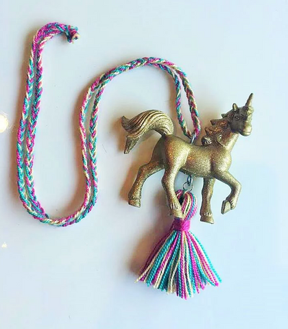 Gold Glitter Unicorn Necklace available at The Groovy gator, Newport RI