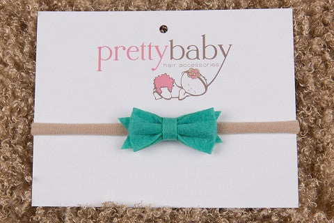 Green bow baby headband, hair band,  green baby bow, skinny headband UK Ireland