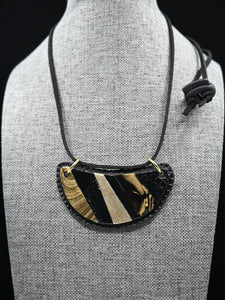 POLYMER JEWELERY, Black and gold crescent-shaped pendant, Carole Charron-Gagnon