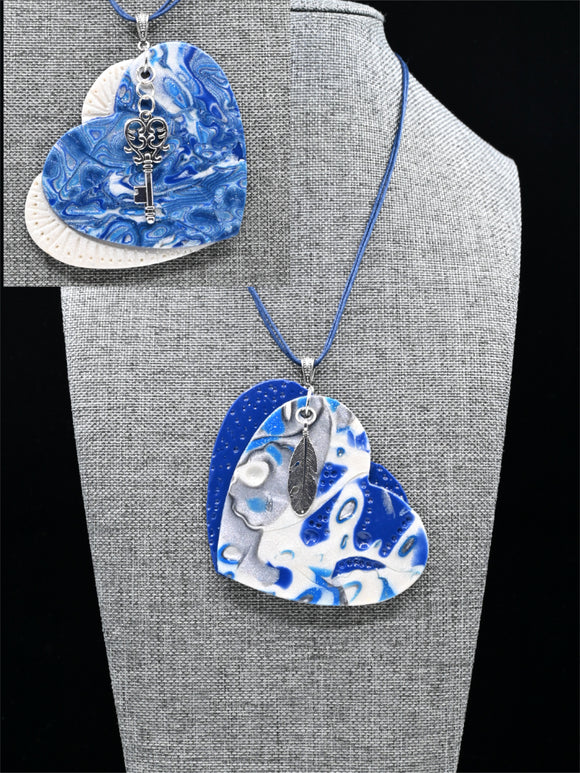 POLYMER JEWELERY, Necklace with large reversible polymer pendant in the shape of a heart, Blue, navy and silver gray series, Carole Charron-Gagnon
