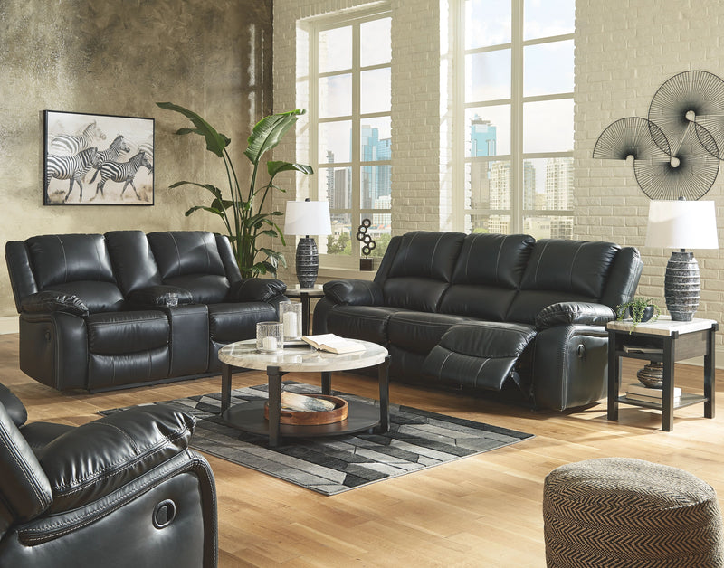 Calderwell - Black - 6 Pc. - Reclining Sofa, Double Reclining Loveseat with Console, Rocker Recliner, Janilly Cocktail Table, End Table, Chair Side End Table