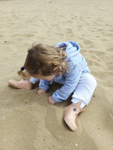 Elin digging in the sand. Pass the bucket and spade please!