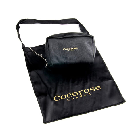 Cocorose London black satin carrier bag tucked into the back pocket of the travel purse, for use of safely carrying removed high heels